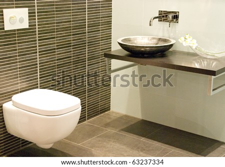 modern bathroom with sink and toilet - stock photo