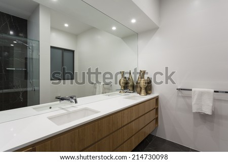 Modern bathroom with stylish ceramic fittings - stock photo