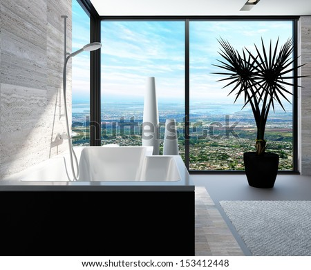 Modern bathtub in a bathroom interior with floor to ceiling windows with panoramic view - stock photo