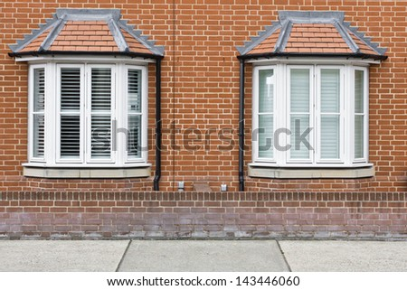 Modern bay windows on adjoining town houses - stock photo