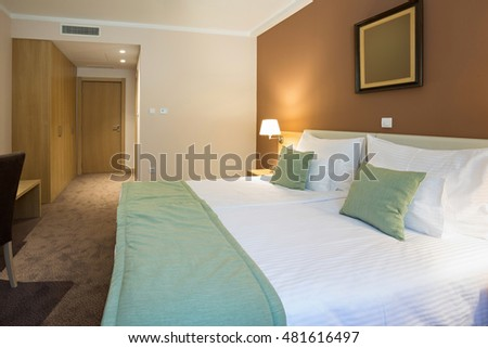 Modern beautiful hotel bedroom interior
