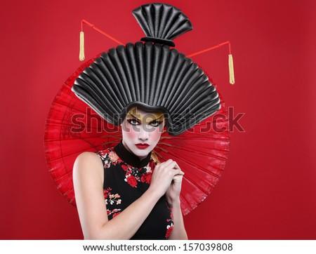 Modern Beauty Concept of a Geisha Girl - stock photo