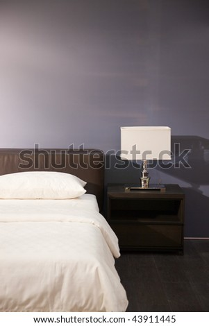 Modern bed room interior -- Lamp and pillows in a new house - stock photo
