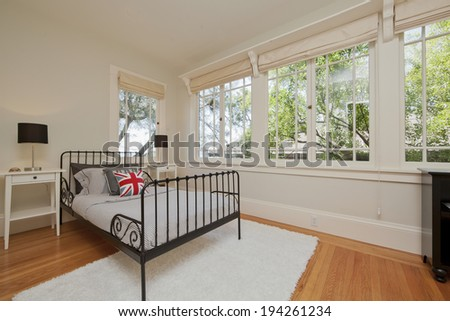 Modern bedroom interior in light beige, English style with view window and pillow - stock photo