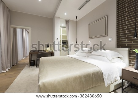 Modern bedroom interior in the evening