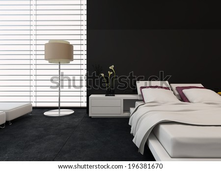 Modern bedroom interior with black and white decor with an adjustable bed and freestanding standard lamp with huge windows covered with blinds - stock photo