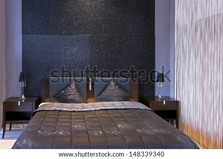 Modern bedroom interior with sparkling wall and furniture - stock photo