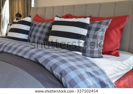 modern bedroom interior with striped pillow on bed - stock photo