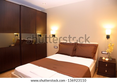 modern bedroom of a luxury apartment - stock photo