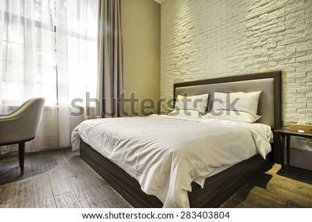 Modern bedroom with decoration - stock photo