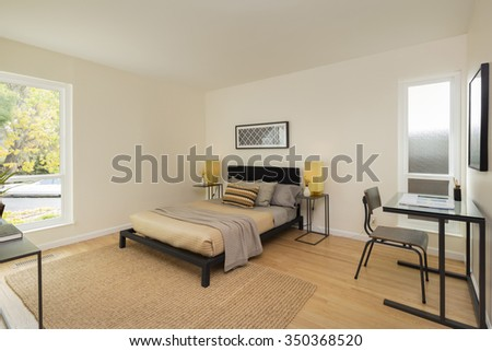 Modern bedroom with desk. - stock photo