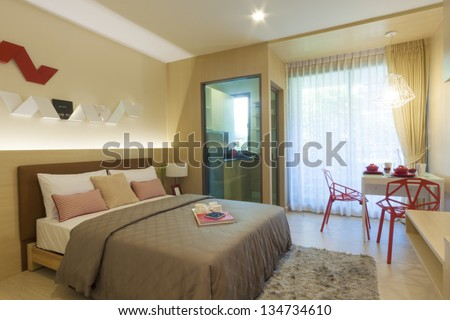 modern bedroom with kitchen room and dining corner. - stock photo
