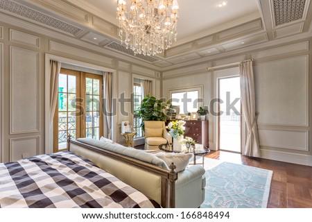 Modern bedroom with wooden floor and big window - stock photo