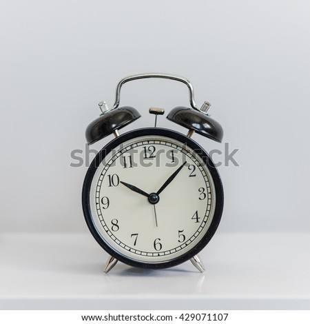 modern black alarm clock on white background