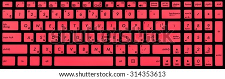 Modern black and crimson laptop keyboard isolated