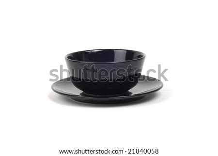 Modern black bowl on matching black plate. Shot with infinity white background - stock photo