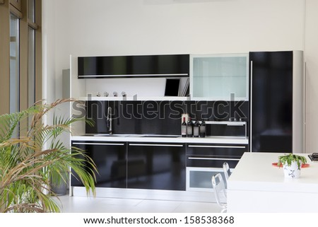 Modern black kitchen design - stock photo