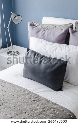 modern black lamp on white table in modern bedroom with blue wall