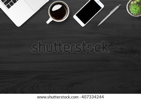 Modern black office table with supplies. Top view with copy space. - stock photo