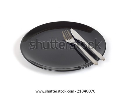Modern black plate with fork and knife. Shot with infinity white background - stock photo