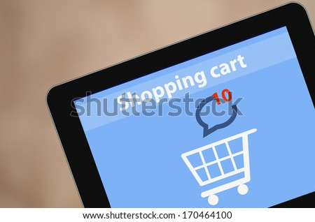 Modern blank Tablet PC screen showing on screen Shopping Cart Flat design Online Shopping concept and Computer Technology e-commerce concept illustration