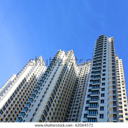 modern blue glass skyscraper perspective view - stock photo