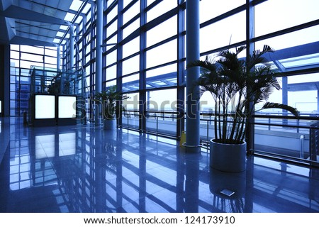 modern blue glass wall of office building - stock photo
