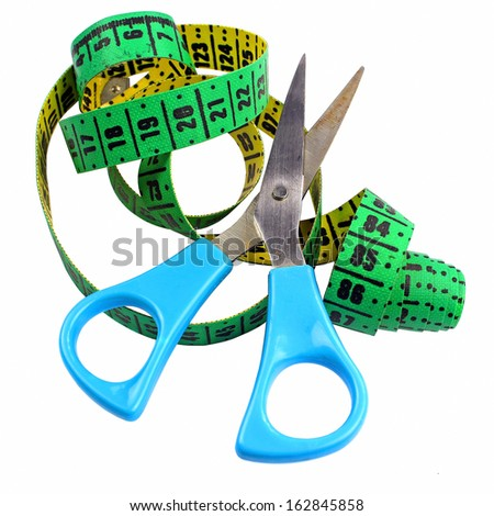 Modern blue scissors and measuring tape isolated