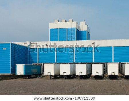 modern blue warehouse with loading docks