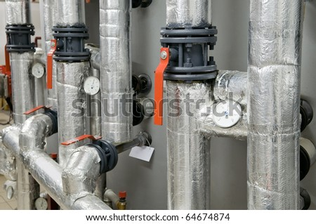 Modern boiler room equipment for heating system. Pipelines, valves, manometers. - stock photo