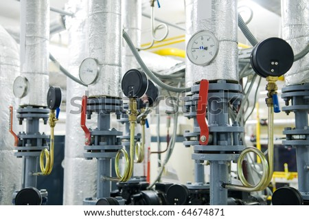 Modern boiler room equipment for heating system. Pipelines, water pump, valves, manometers. - stock photo