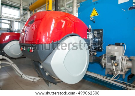 Modern boiler room equipment- high power boiler burner. Boiler room. Water heating. Power supply. Water supply.