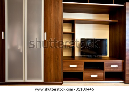 modern bookcase and wardrobe with TV-sistem - stock photo