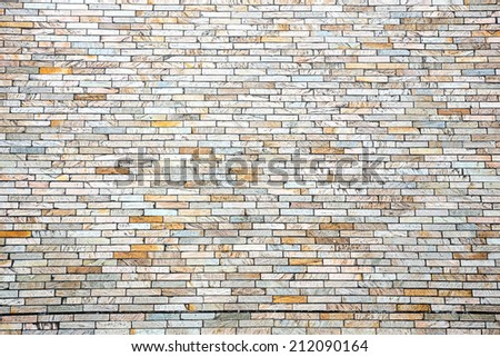 Modern brick wall using as background - stock photo