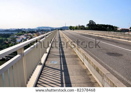 Modern bridge and the shadow of the balustrade