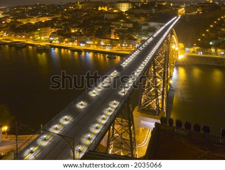 modern bridge at nighttime; view from above