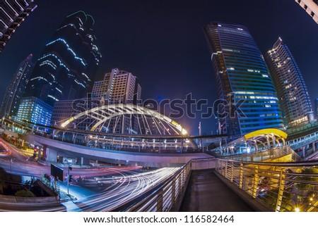 Modern bridge at train station in big town. - stock photo