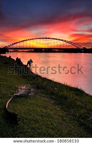 Modern bridge during sunset at Putrajaya, Malaysia - stock photo