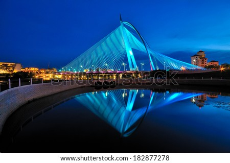 Modern bridge during sunset in blue colour - stock photo