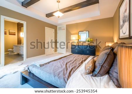 Modern bright bedroom interior with designer pillows in a luxury house. - stock photo