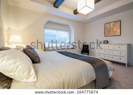 Modern bright bedroom interior with designer pillows in a luxury house, hotel. - stock photo
