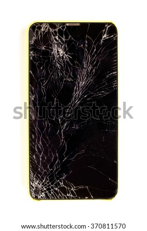 Modern broken mobile phone on white background.  Top view