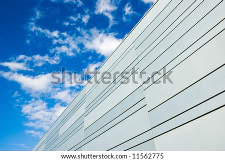 modern building and clouds on the blue sky