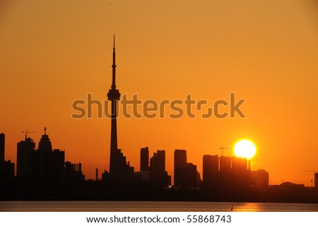 Modern building and CN Tower in downtown Toronto as silhouette - stock photo