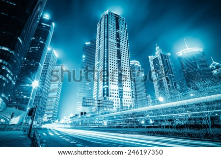 modern building at night with light trails in shanghai financial district - stock photo
