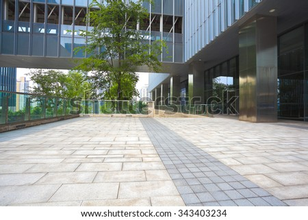 Modern building background with empty road floor