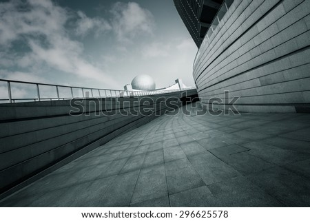 Modern building exterior and empty footpath floor - stock photo