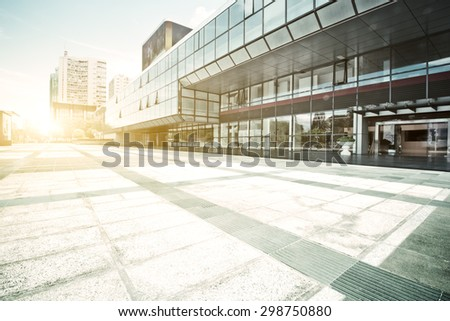 modern building glass wall and empty path - stock photo