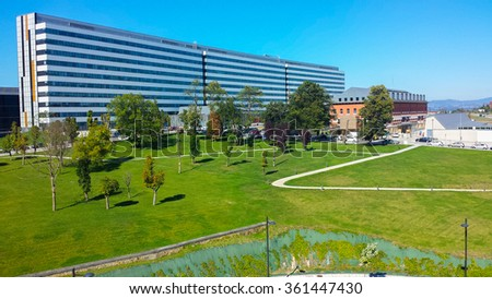 modern building in a green meadow - stock photo