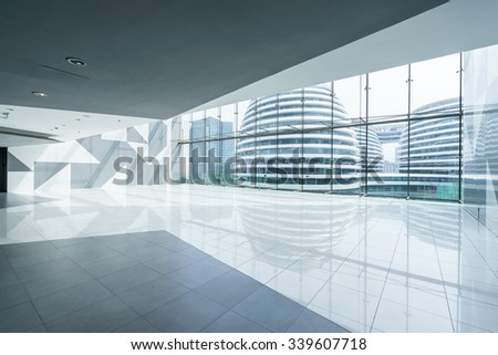modern building interior and through window empty floor